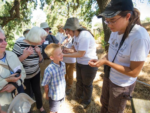 Image of a student leading a bird banding tour in the UC Davis Putah Creek Riparian Reserve.