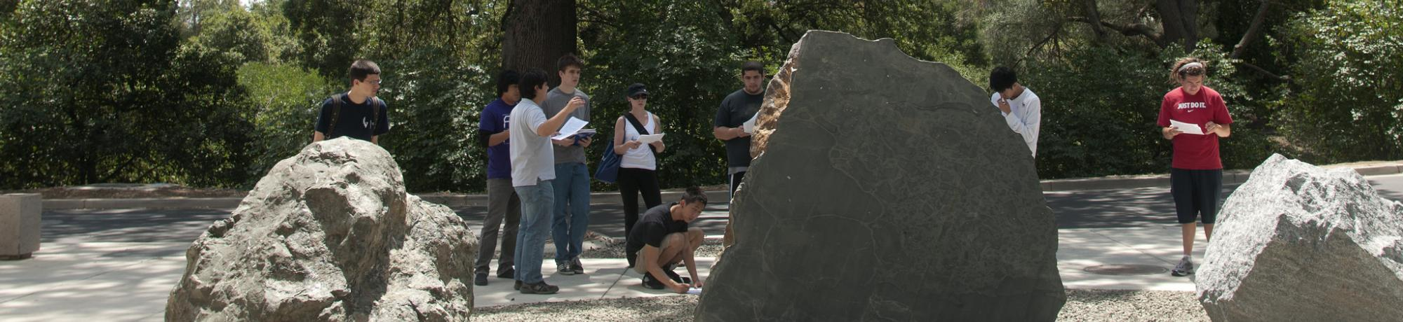 Image of geology students studying the rocks in the UC Davis California Rock Garden.